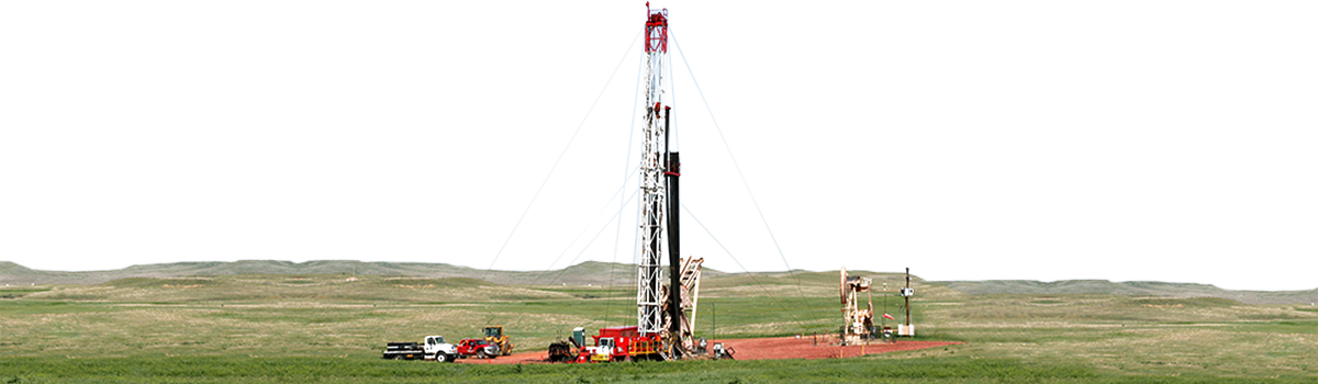 Well drilling rig in a field